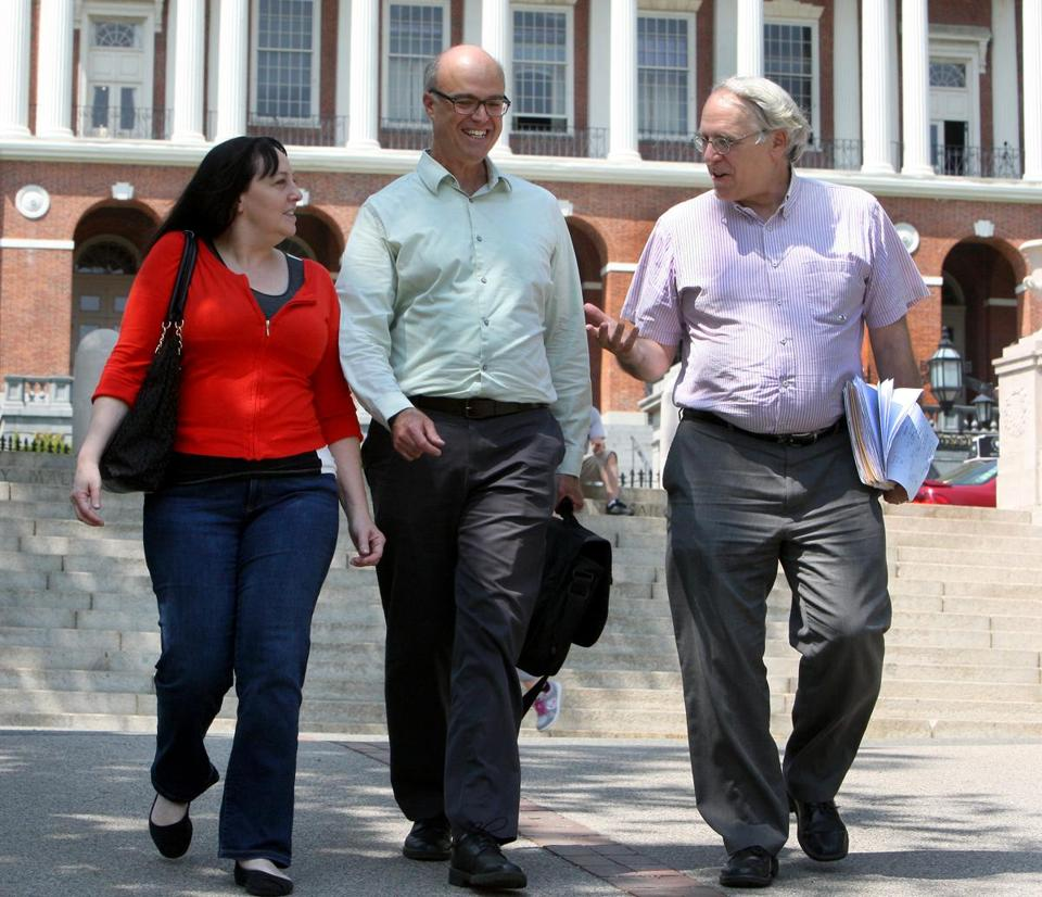 "Boston, MA: 05-25-2016: (l-r) Deb Fastino, Harris Gruman and Lew Finfer, the founders of the Raise Up organization, photographed outside the State House in Boston, Mass. May 25, 2016. The group is pushing the ""millionaire's tax"" for Massachusetts. Photo/John Blanding, Boston Globe staff story/Josh Miller, Metro ( 27RaiseUp )"