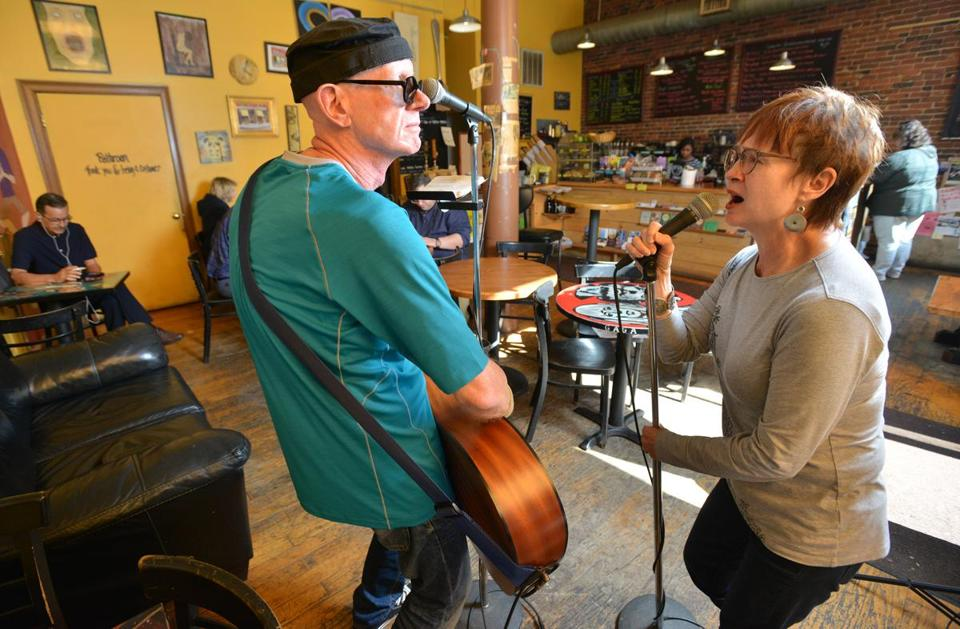 Christopher and Karen Payne-Taylor at Brewed Awakenings coffeehouse in Lowell.