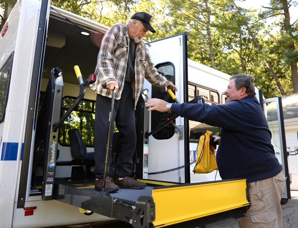 Hingham 10/02/2017: Retired Food Service Director, John Callahan (right) helps Bruce Gunderson of Hingham from the van after he picked him up from his appointment at Weymouth Dialysis. Callahan who is from Pembroke, is a medical driver for the Hingham Senior Center. Photo by Debee Tlumacki for the Boston Globe (south)