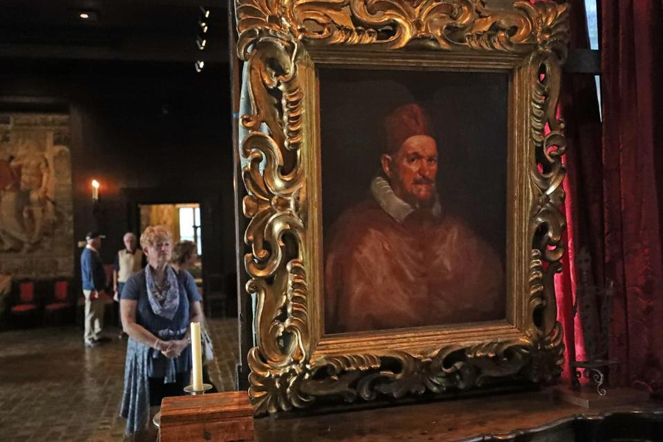 BOSTON, MA - 10/02/2017: Art work ÒPope Innocent X,Ó c. 1650 Isabella Stewart Gardner Museum This papal portrait after Diego Velazquezcq hangs in front of an Italian desk, very handsome, walnut, with brass fittings, c. 1700. Presumably, Mrs. Gardner used to sit at it and gaze at the painting. MUSEUM VIEWS, the aesthetics of placing art in museums (David L Ryan/Globe Staff ) SECTION: ARTS TOPIC 15views