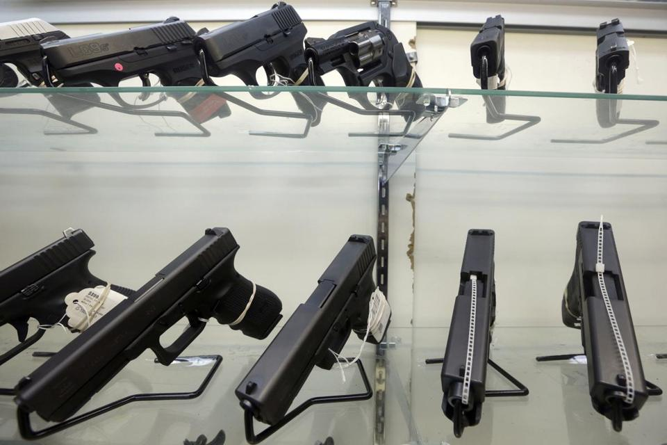 This Wednesday, June 29, 2016, photo shows guns on display at a gun store in Miami. After a gunman killed more than 50 people in Las Vegas in the nation's latest mass shooting, stocks in the gun industry rose, Monday, Oct. 2, 2017. (AP Photo/Alan Diaz)