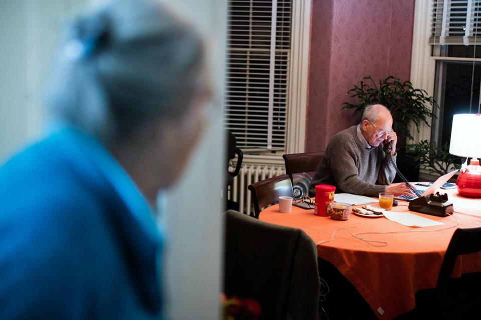 Rainer Weiss (right) spoke on the phone with the Nobel Prize ceremony in Stockholm, Sweden, shortly after learning he won the 2017 Nobel Prize in Physics for his Laser Interferometer Gravitational-Wave Observatory (LIGO) work as his wife Rebecca (left) looks on in their home in Newton