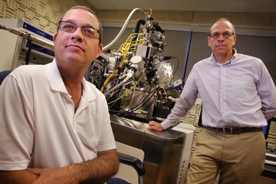 Don Burl (left) and John Notte work at Carl Zeiss Microscopy, which is developing a microscope that is key to studying Alport syndrome.