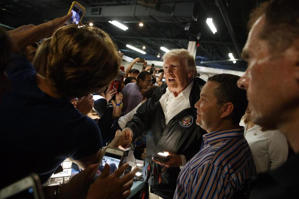 President Donald Trump shook hands and hands out flashlights and other supplies at Calvary Chapel in Guaynabo, Puerto Rico on Tuesday.