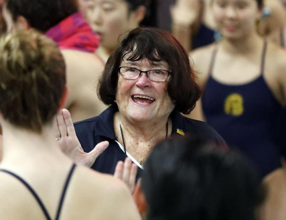 "Andover coach Marilyn Fitzgerald, high-fiving one of her swimmers during a meet, said after 48 years of coaching ""it was just the right time"" to retire."