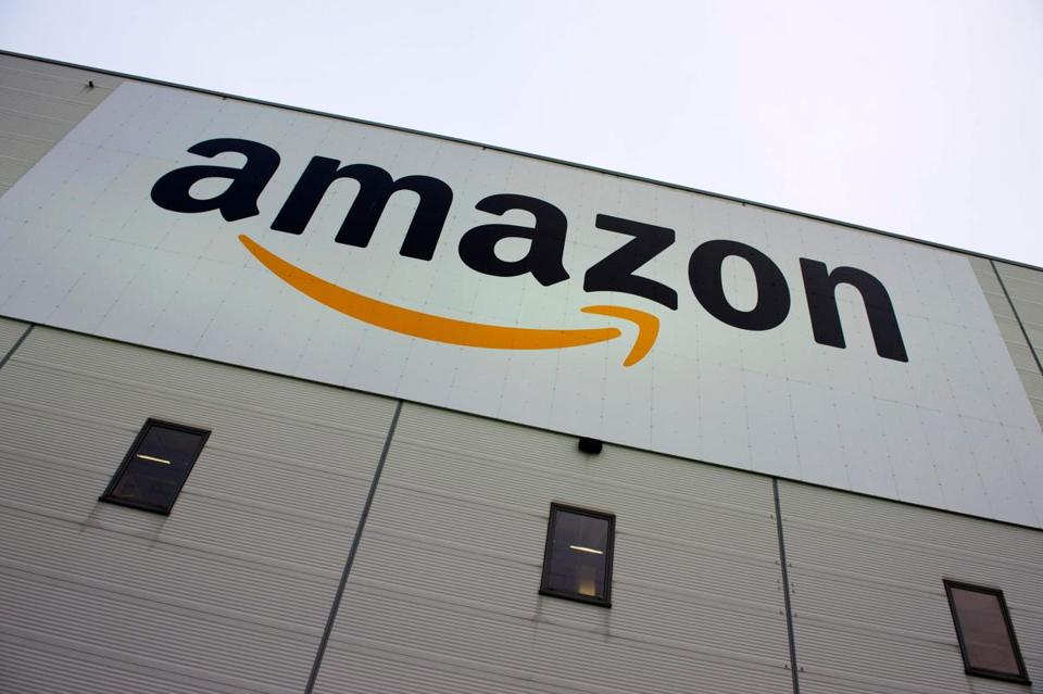 "(FILES) This file photo taken on November 11, 2014 shows the logo of US online retail giant Amazon displayed on the Brieselang logistics center, west of Berlin. EU competition chief Margrethe Vestager on October 4, 2017 ordered Amazon to pay 250 million euros in back taxes linked to an ""illegal tax break"" that Luxembourg granted the internet shopping giant. ""Luxembourg gave illegal tax benefits to Amazon. As a result, almost three quarters of Amazon's profits were not taxed,"" Vestager said in a statement. / AFP PHOTO / John MACDOUGALLJOHN MACDOUGALL/AFP/Getty Images"