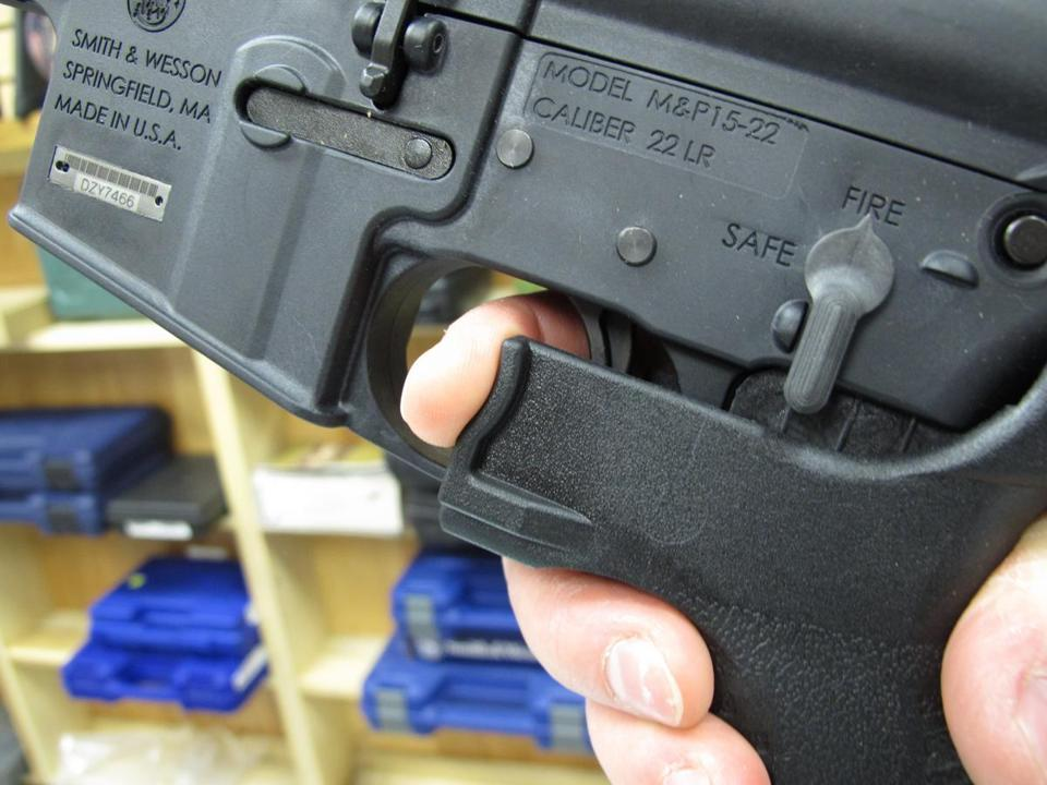 An employee at a Raleigh, N.C., firearms store demonstrates how the legal bump stock device works on a semiautomatic weapon.