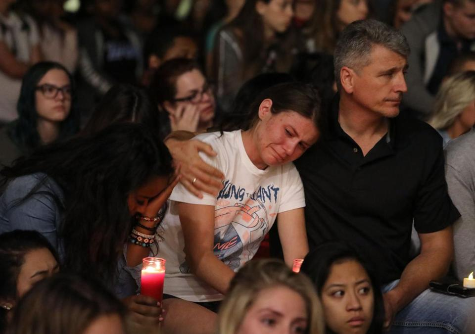 Mourners reacted at a vigil for Las Vegas victims Monday.