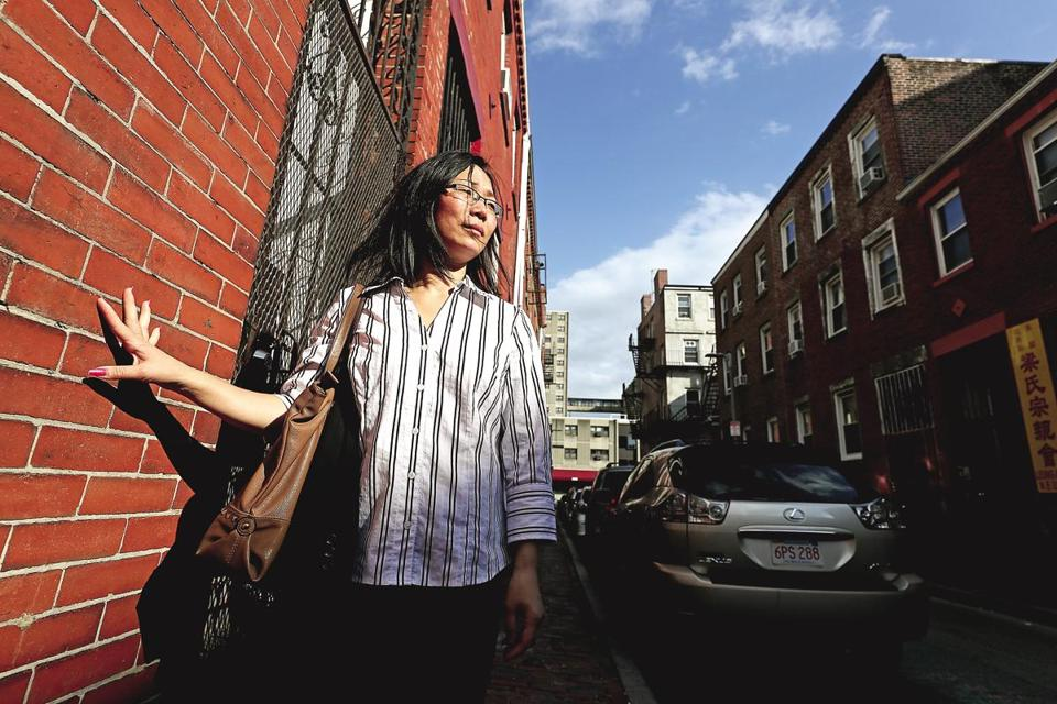 Mei Qun Huang stood near her former apartment on Johnny Court, which she heard was now being used as a short-term rental.