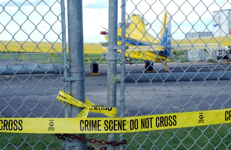 The crop-dusting airplane that 9/11 terrorist Mohamed Atta once allegedly tried to rent sat idle behind police tape Sept. 24, 2001, on a Belle Glades, Fla., airfield.