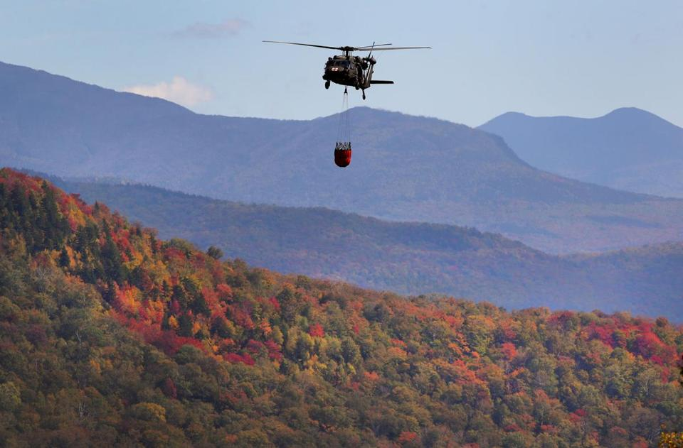 A Black Hawk helicopter flew to dump 600 gallons of water near the peak of the 600-foot high ridge.