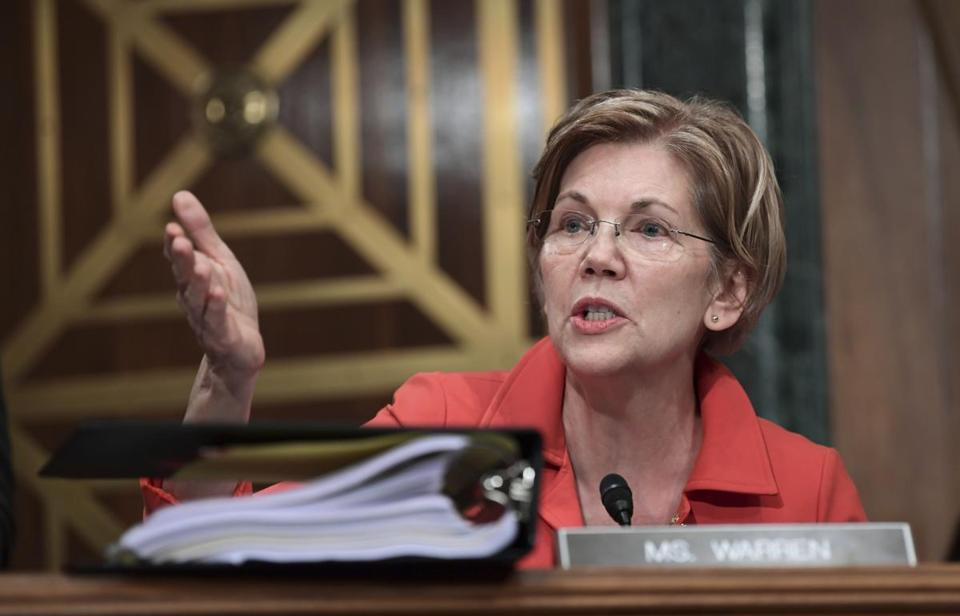 Sen. Elizabeth Warren, D-Mass., questions Wells Fargo Chief Executive Officer and President Timothy Sloan as he testifies before the Senate Committee on Banking, Housing and Urban Affairs on Capitol Hill in Washington, Tuesday, Oct. 3, 2017. (AP Photo/Susan Walsh)