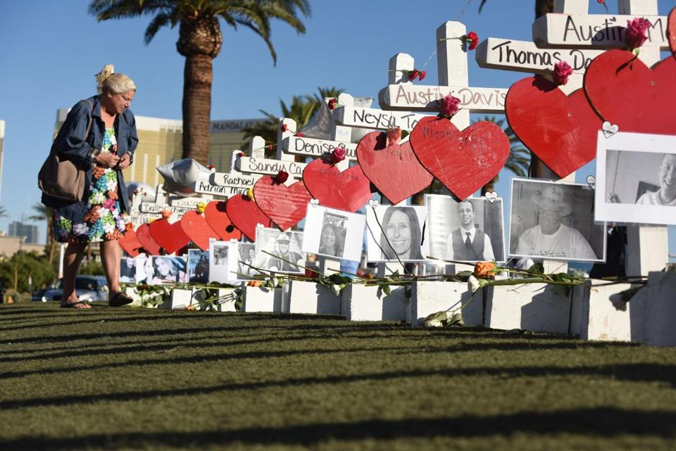 A Las Vegas resident visited crosses erected to honor victims of last  Sunday's mass shooting on