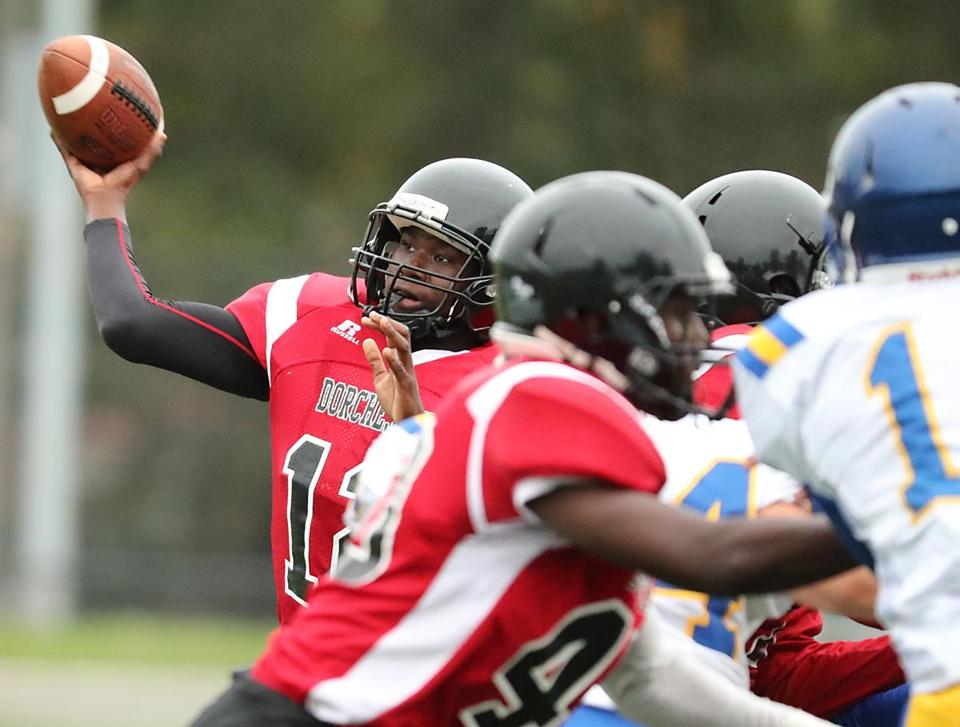 Dorchester Ma 10/6/17 TechBoston quarterback Mark Senacharles throws a pass against East Boston during first half action at Roberts Field. (Matthew J. Lee/Globe staff) topic reporter