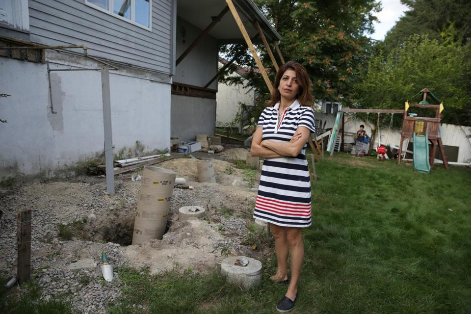 Marjan Sadegh, next to the remains of her backyard deck.
