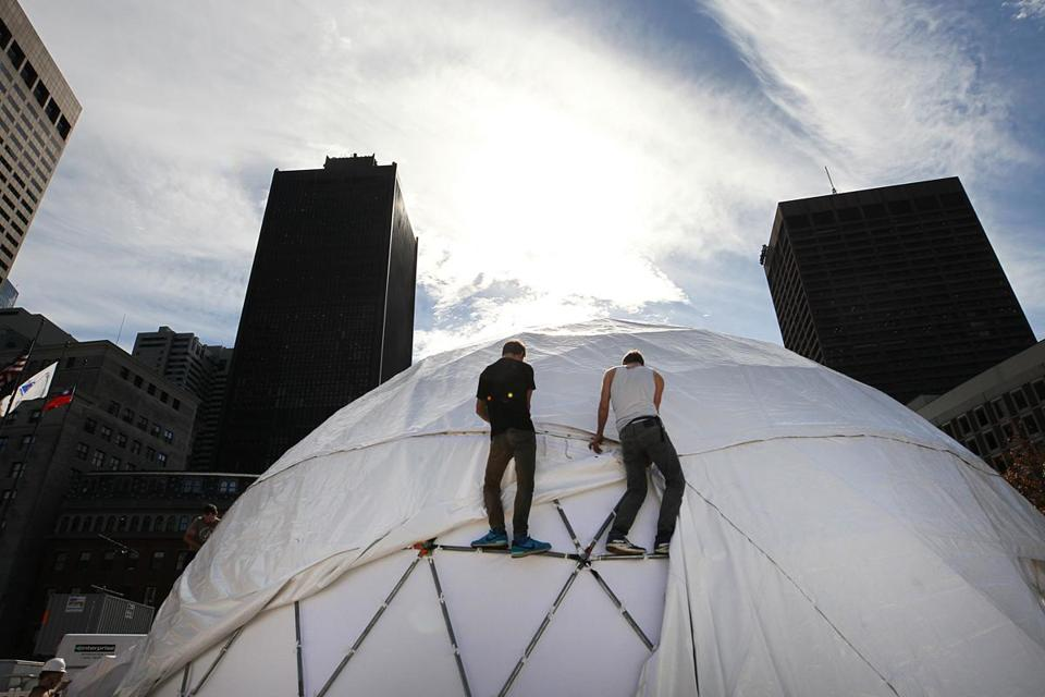 HUBWeek is getting under way with the building of the giant domes on City Hall Plaza.