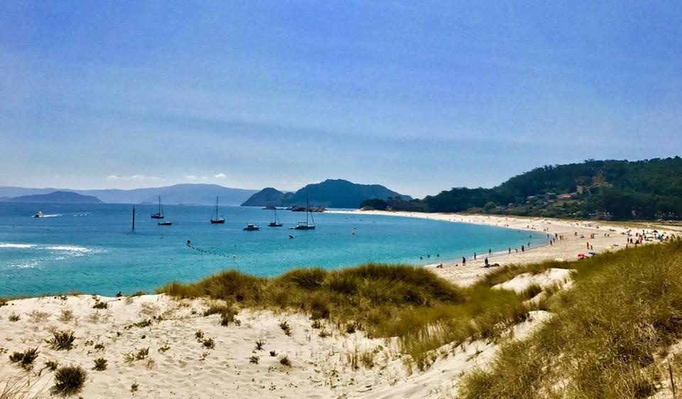 The white sand and deep blue water of Playa de Rodas entice visitors to the Cies Islands in Spain