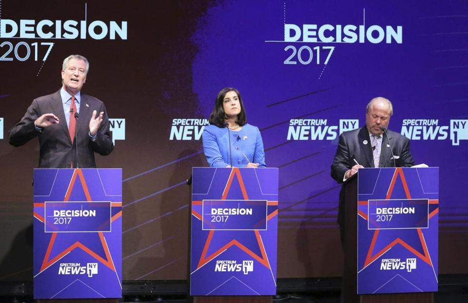 Mayor Bill de Blasio (left), Republican mayoral candidate Nicole Malliotakis, and independent candidate Bo Dietl (right) attended a debate at Symphony Space in New York Tuesday.