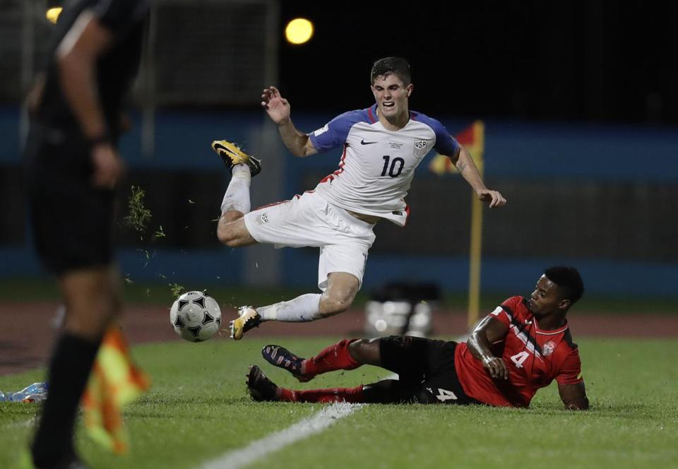 Christian Pulisic (top) is fouled by Trinidad and Tobago's Kevon Villaroel during their World Cup qualifier.