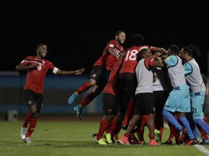 Trinidad and Tobago players celebrated after scoring their second goal against the United States.