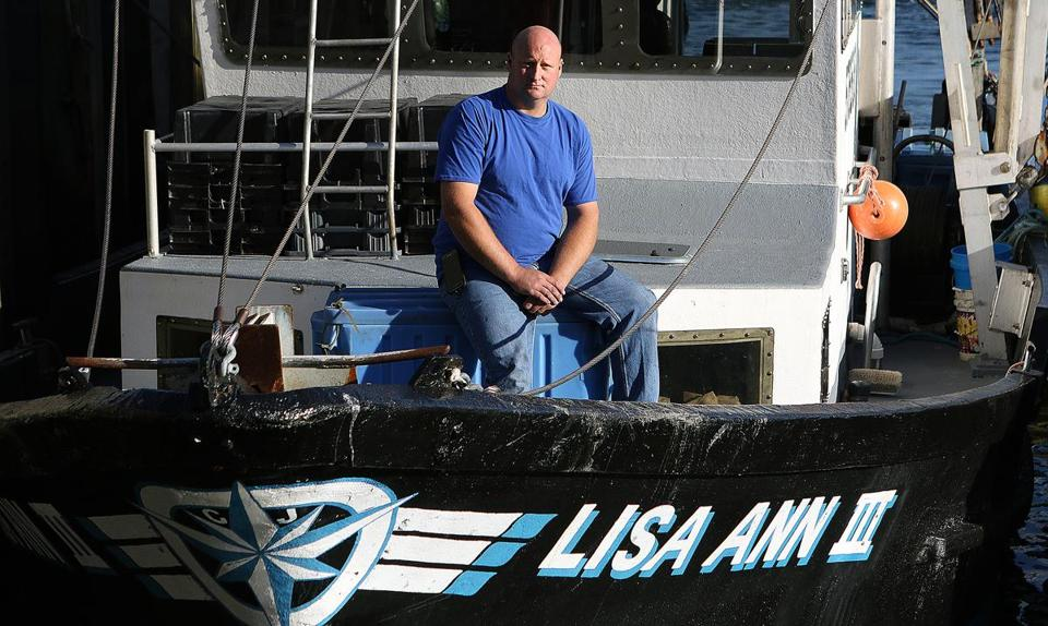 Jim Ford aboard his boat, the Lisa Anne III, in Newburyport.