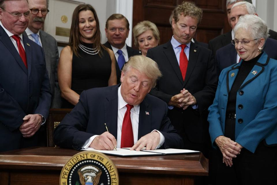 President Trump signed an executive order on health care in the Roosevelt Room of the White House on Thursday.