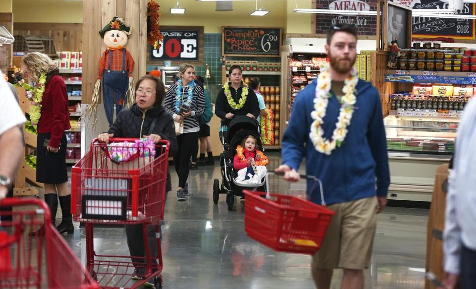 Opening-day customers at the Trader's Joes in Allston got leis to wear;