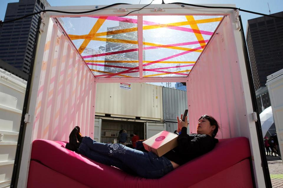 Boston, MA- October 12, 2017: Alice Kaanta relaxes in a Pop-up Play Cube while exploring HUBweek on City Hall Plaza in Boston, MA on October 12, 2017. (CRAIG F. WALKER/GLOBE STAFF) section: metro reporter: