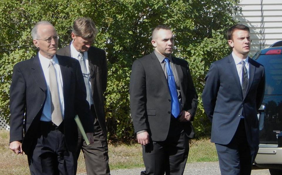 Massachusetts State Trooper Joseph Flynn (second from right) arrived with his attorneys last week for the jury view of the scene where he and other officers arrested Richard Simone Jr. last year.