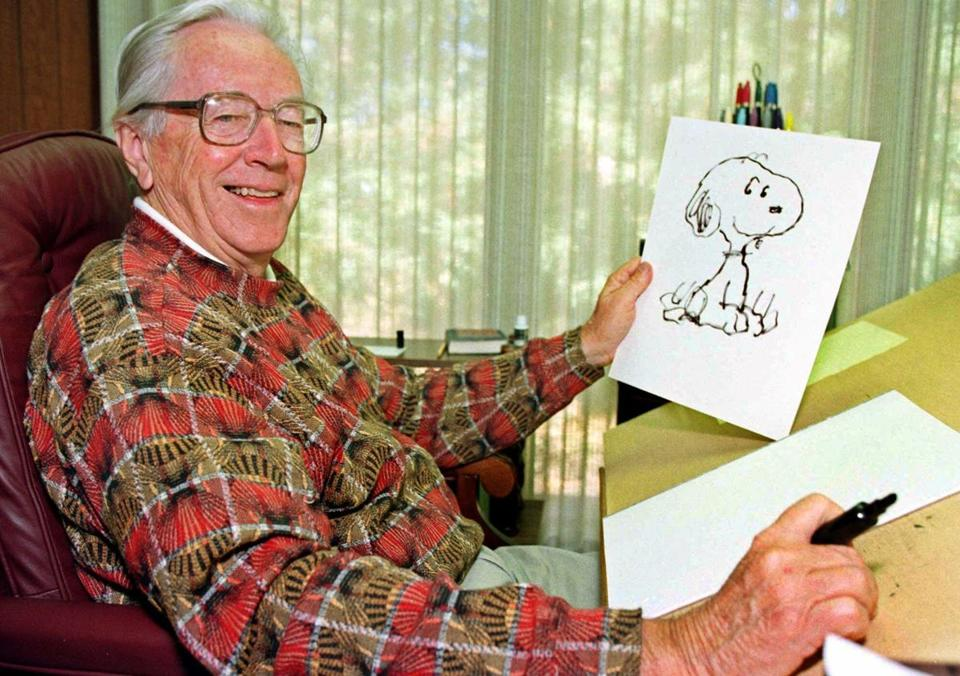 "Cartoonist Charles Schulz displays a sketch of his beloved character ""Snoopy"" in his office in Santa Rosa, Calif."