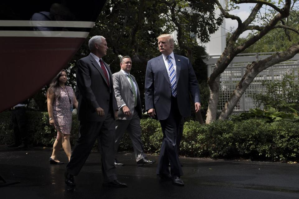 President Donald Trump and Vice President Mike Pence walked on the South Lawn, at the White House in July 2017. Less than 12 hours after Trump reluctantly agreed that Iran has been honoring the nuclear agreement, the administration announced new Iran-related sanctions on Tuesday intended to show its toughened stance toward the country.