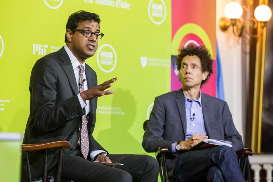 Author Malcolm Gladwell (right) listened to Dr. Atul Gawande at Faneuil Hall Friday during a HUBweek event.
