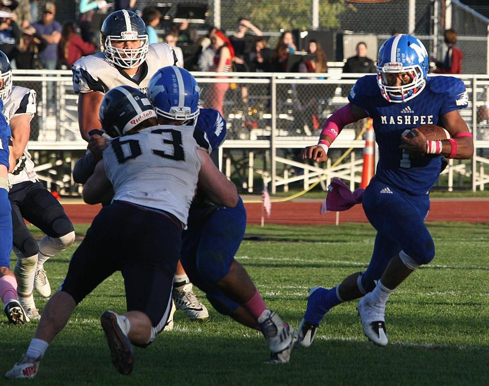 MASHPEE, MA. 082617--Nantucket at Mashpee football in a matchup of Division 7 South unbeatens. Here, Mashpee's #1 Devaun Ford makes a break at the end of the line into open field. (Steve Haines/For the Boston Globe)