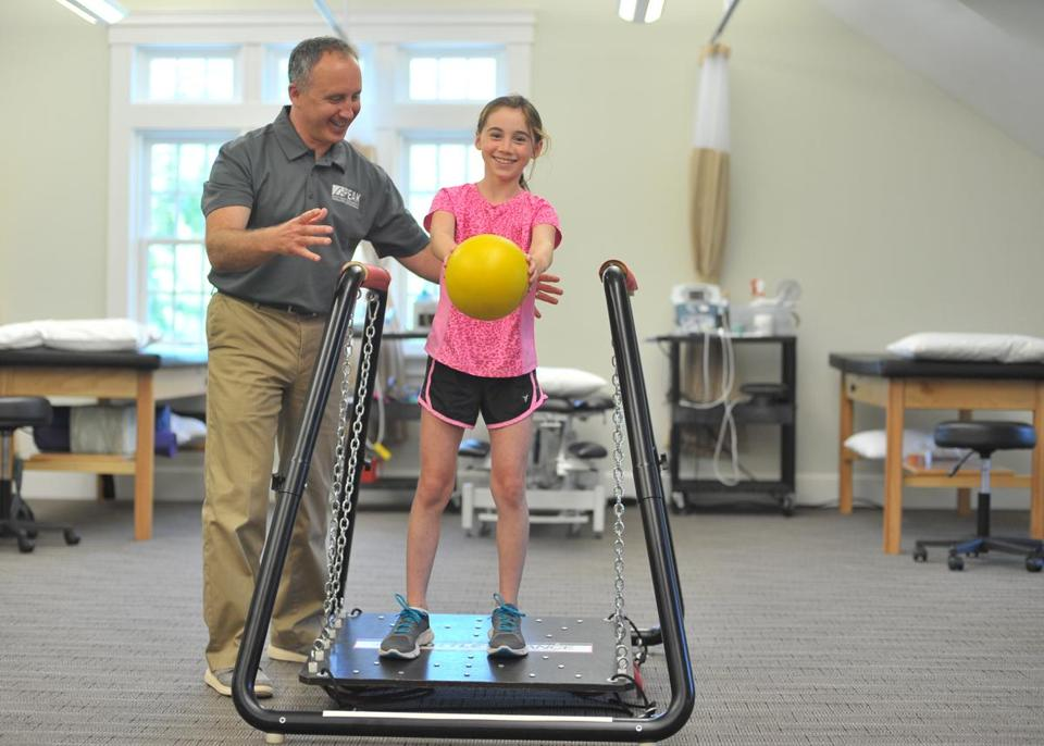 9sosmallbiz - Eric Edelman and daughter Sarah Grace Edelman, he's demonstrating physical therapy exercises. He owns Peak Physical Therapy & Sports Performance. (Handout)