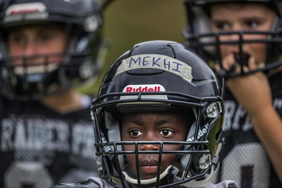 Mekhi Martin, in his protective helmet, sizes up the action.