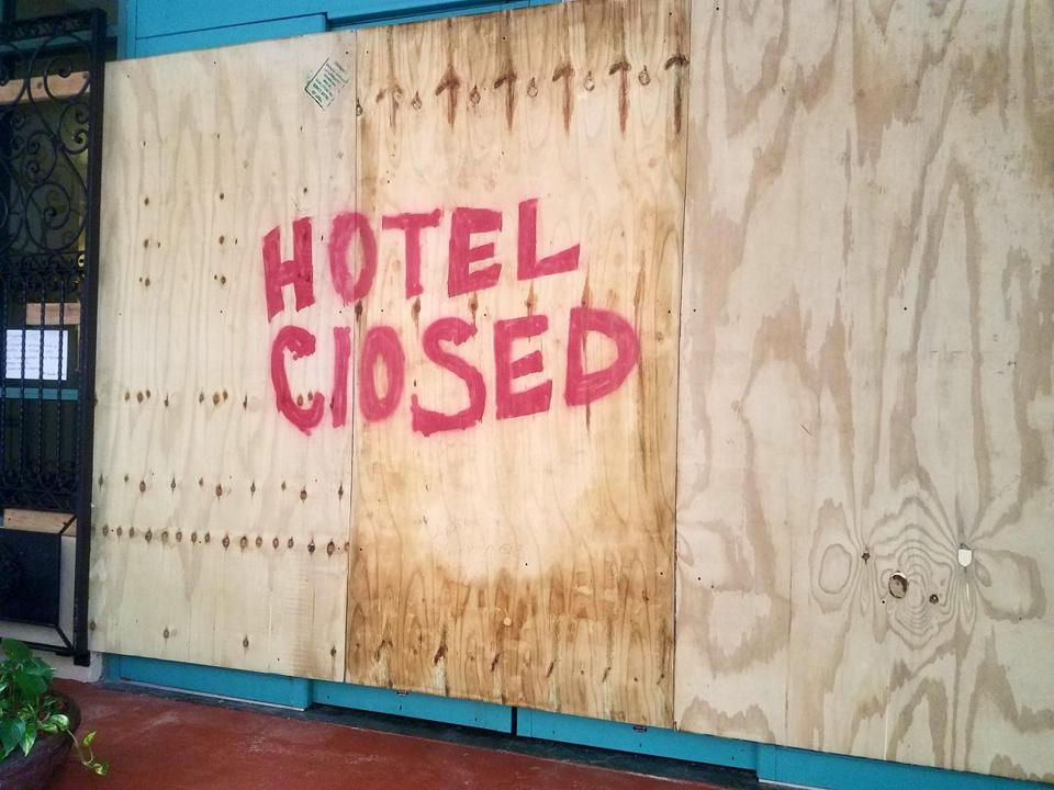 A plywood sign declared that a hotel in old San Juan was not open for business.