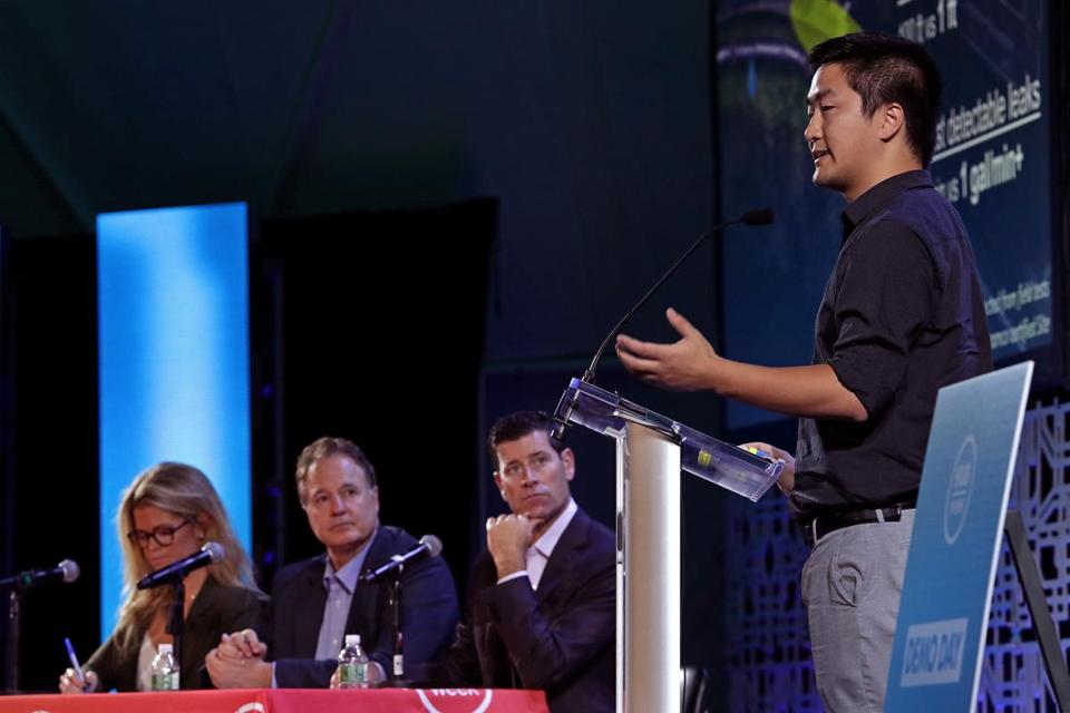 Boston, MA - 10/14/2017 - You Wu, Co-Founder of PipeGuard, delivers his pitch to Demo Day judges from L to R: Holly Maloney McConnell of General Catalyst, Steve Pagliuca of Bain Capital and The Boston Celtics, and Miceal Chamberlain Jr, Bank of America. The company won first place and the Grand Prize at today's Demo Day final judging. - (Barry Chin/Globe Staff), Section: Lifestyle, Reporter: Dugan Arnett, Topic: 15HubDemo, LOID: 8.3.4029560868.