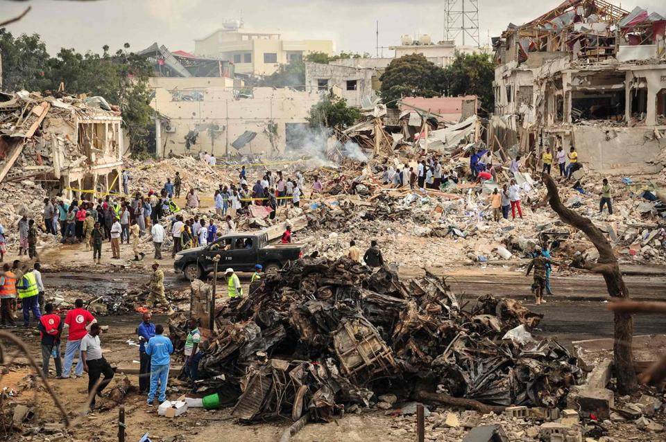 Bodies and bloodied slippers and shoes scattered in the aftermath of the bombings in Mogadishu, and windows of nearby buildings were shattered.