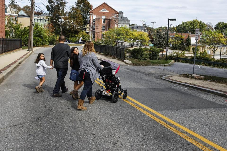 Heading to the park across the street from their new home are boyfriend Jonathan Carrion, second from left, with daughters Sophia, left and Lily, middle, and Colby Jackman, right, with her daughter Sophia Jackman, 4, in Methuen, MA. Saturday, Oct. 14, 2017. 4-year-old Sophia Jackman has an extremely rare genetic disease called Rhizomelic Chondrodysplasia Punctata, or RCDP. It prevents her from growing at a normal rate. She weighs only 15 pounds and suffers many disabilities, both physical and cognitive. CREDIT: Cheryl Senter for The Boston Globe