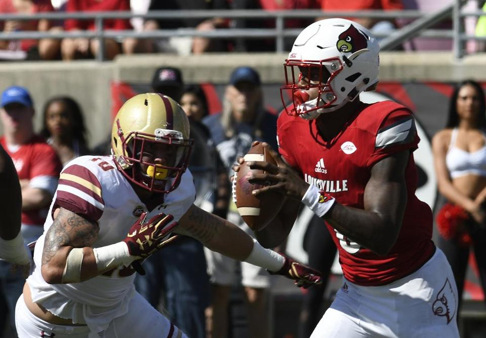 Louisville quarterback Lamar Jackson (8) is pursued by Boston College linebacker Ty Schwab (10) during the first half of an NCAA college football game, Saturday, Oct. 14, 2017, in Louisville, Ky. (AP Photo/Timothy D. Easley)