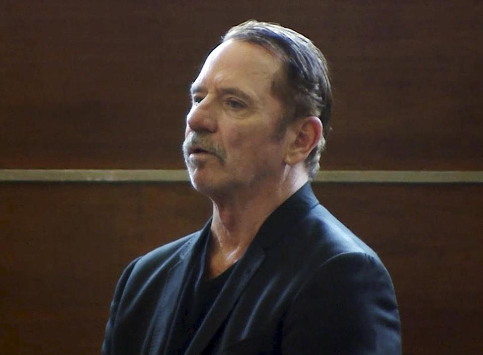 Tom Wopat stands during arraignment, in Waltham.