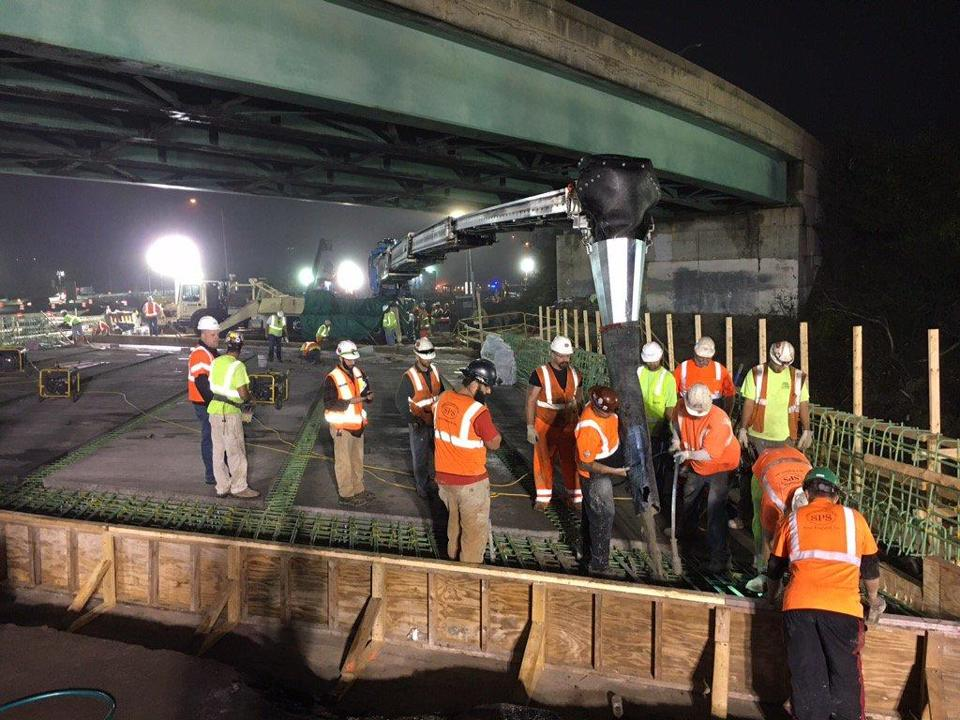 Crews poured concrete as part of the bridge replacement project.