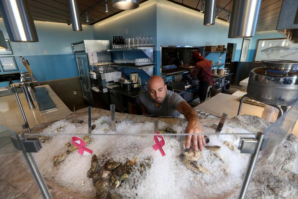 Ralph Ravesi prepares a selection of oysters at Eventide Fenway.