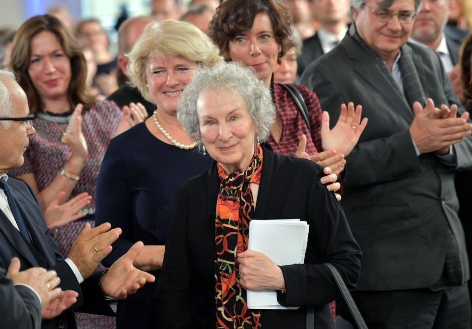 FRANKFURT AM MAIN, GERMANY - OCTOBER 15: Guest applaud Margaret Atwood during the 'Peace Prize of the German Book Trade' ceremony of German Publishers and Booksellers Association, at St. Paul's Church (Paulskirche) on October 15, 2017 in Frankfurt am Main, Germany. The Board of Trustees of the Peace Prize of the German Book Trade has chosen the Canadian author, essayist and poet Margaret Atwood to be the recipient of this year's Peace Prize. The Peace Prize has been awarded since 1950 and is endowed with a sum of 25,000 Euro. (Photo by Thomas Lohnes/Getty Images)