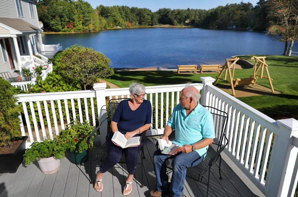 Plymouth-10/17/17- Cheryl and Brad Leonard, both 71 moved frm Middleborough to their condo in Plymouth overlooking Clear Pond. They love their deck, and spend many hours reading together there. (John Tlumacki/Globe staff) (south)