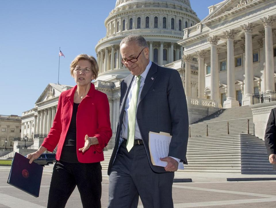 Sen. Elizabeth Warren, D-Mass., left, and Senate Minority Leader Chuck Schumer, D-N.Y., walk to a news conference on the Republican tax and budget proposals, at the Capitol in Washington, Wednesday, Oct. 18, 2017. (AP Photo/J. Scott Applewhite)
