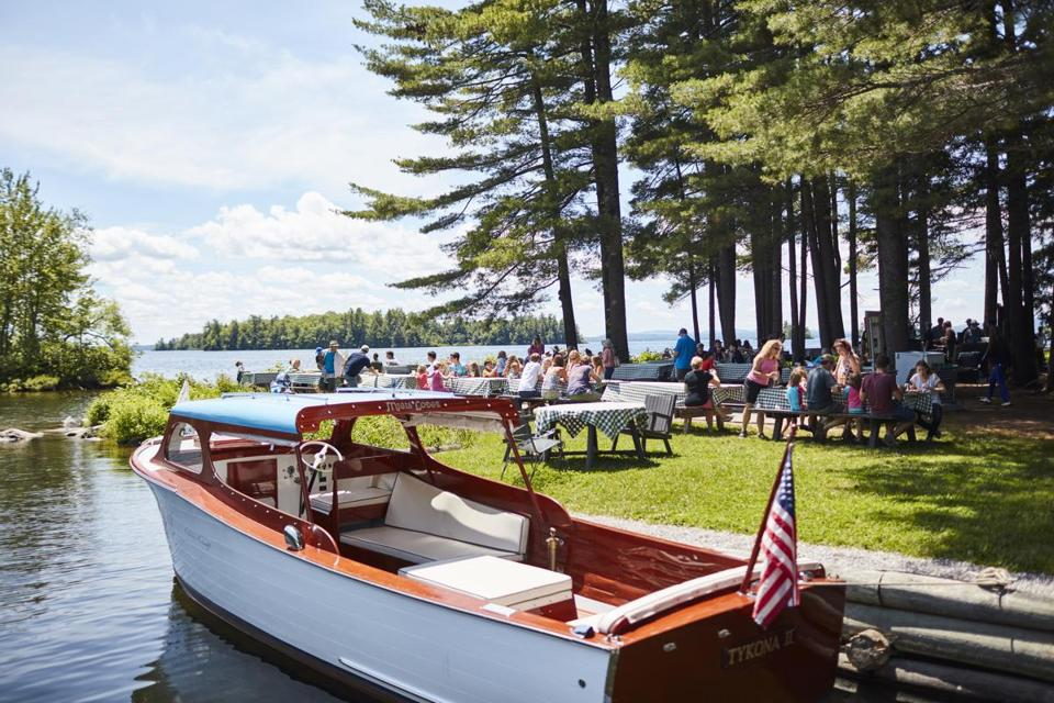 Migis Lodge on Sebago Lake in Maine offers lunch on a private island via the camp's vintage wooden 1940s lake cruiser.