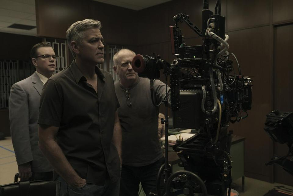 "From left: Matt Damon, director George Clooney, and cinematographer Robert Elswit on the set of ""Suburbicon."""