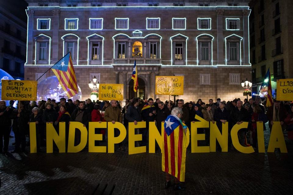Catalan pro-independence supporters held flags late last year during a demonstration in Saint Jaume square in Barcelona.
