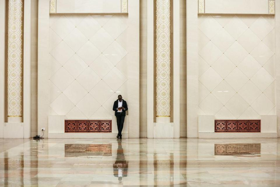 A man waited in the Great Hall of the People during delegation discussions at the 19th National Congress of the Communist Party of China in Beijing.